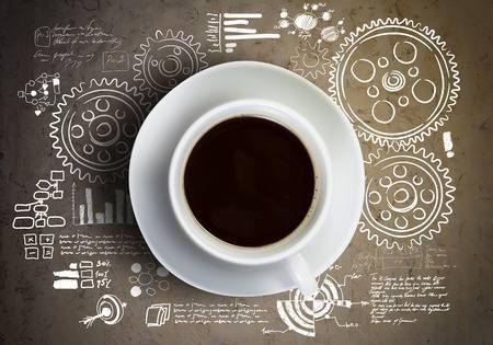 31057962-close-up-de-tasse-de-café-et-roues-dentées-au-fond