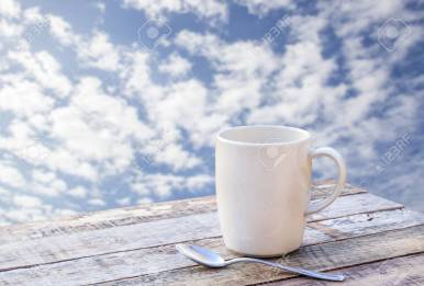Coffee cup on wooden table with blurr background