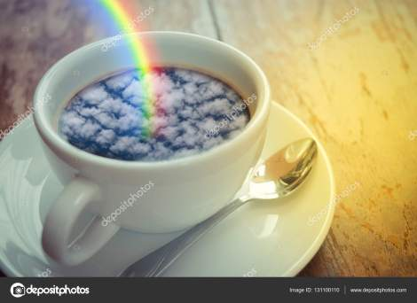 Blue sky cloud with rainbow reflection on coffee